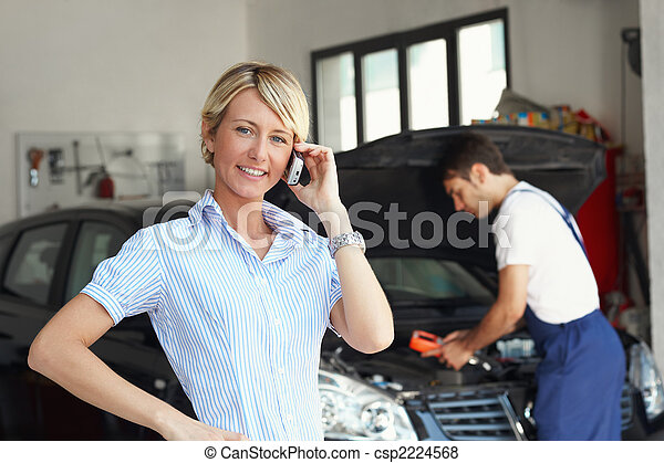 woman in auto repair shop - csp2224568