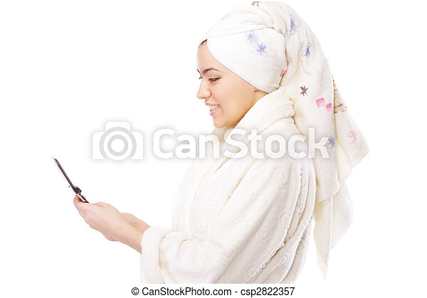 Woman in bathrobe with phone sideview - csp2822357