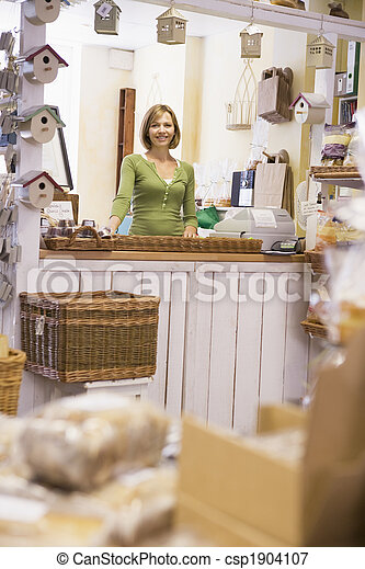 Woman in birdhouse store smiling - csp1904107