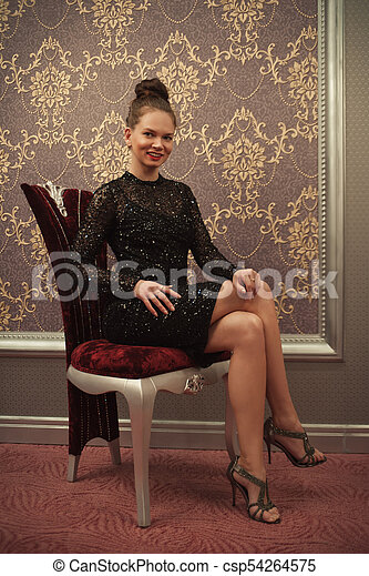 Woman in black dress - csp54264575
