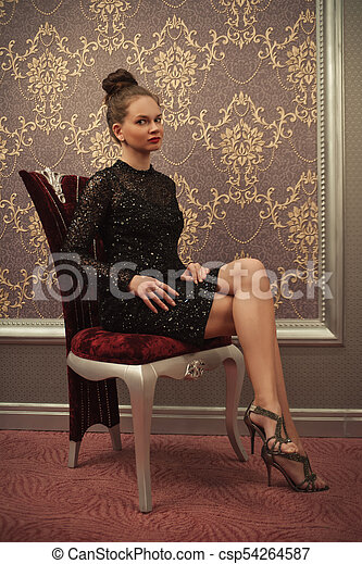 Woman in black dress - csp54264587