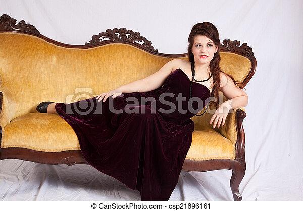 Woman in black dress reclining - csp21896161