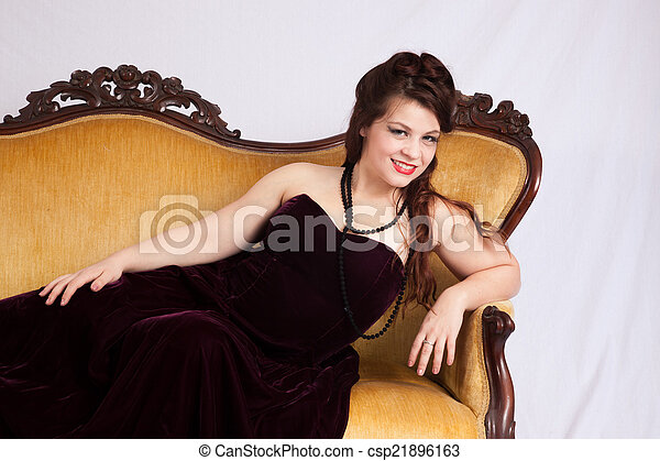 Woman in black dress reclining - csp21896163