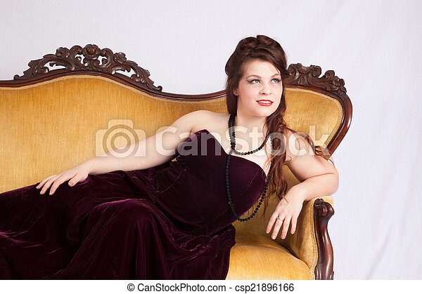 Woman in black dress reclining - csp21896166