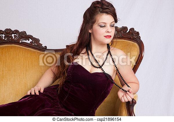 Woman in black dress reclining - csp21896154