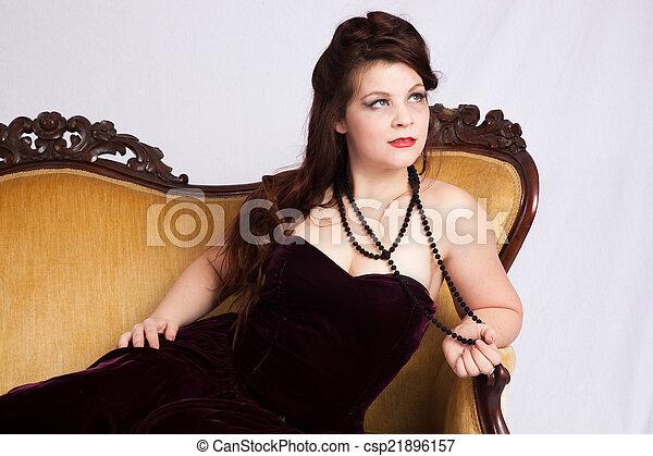 Woman in black dress reclining - csp21896157