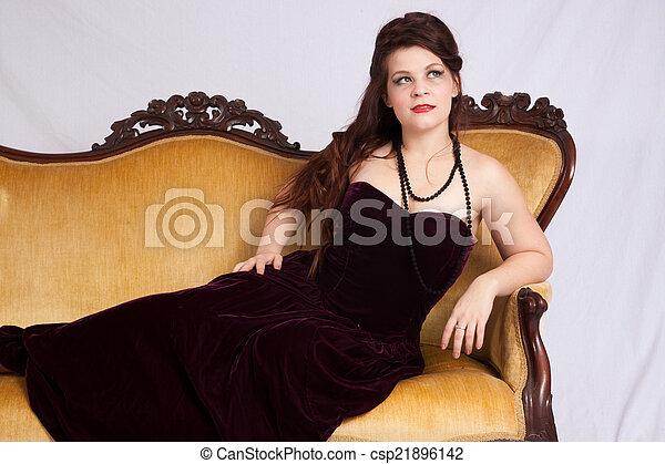Woman in black dress reclining - csp21896142