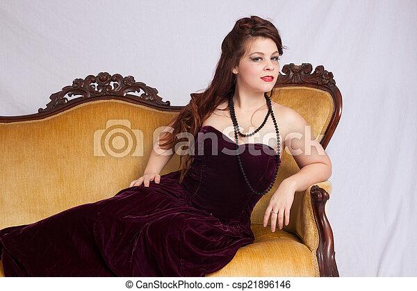 Woman in black dress reclining - csp21896146