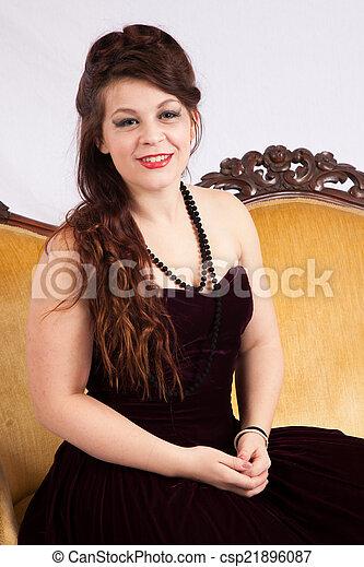 Woman in black dress smiling - csp21896087