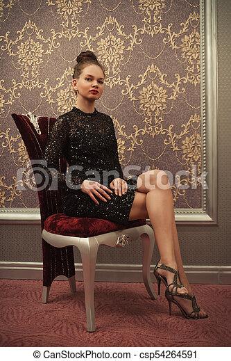 Woman in black dress - csp54264591