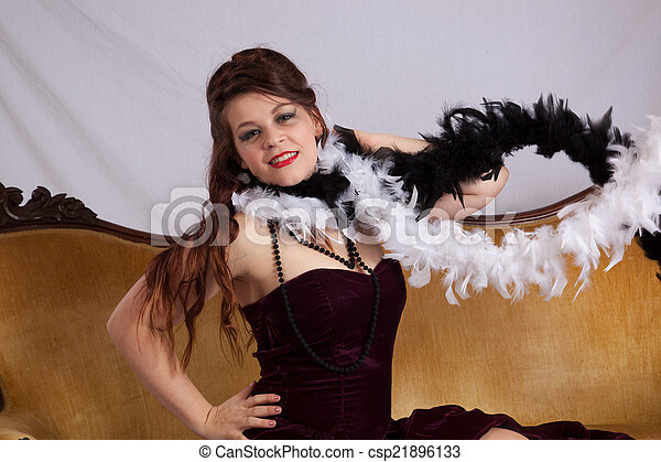 Woman in black dress with boa - csp21896133