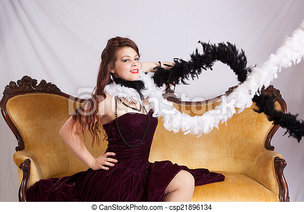 Woman in black dress with boa - csp21896134