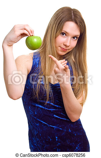 woman in blue dress with a green apple - csp6078256