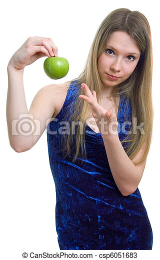 woman in blue dress with a green apple - csp6051683