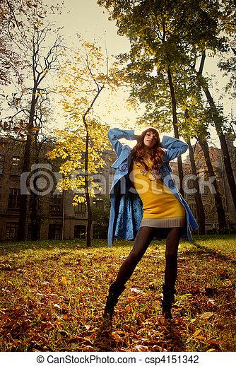 Woman in blue jaket posing in autumn park - csp4151342