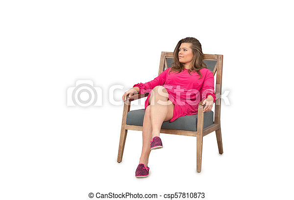 woman in dress sitting on chair - csp57810873