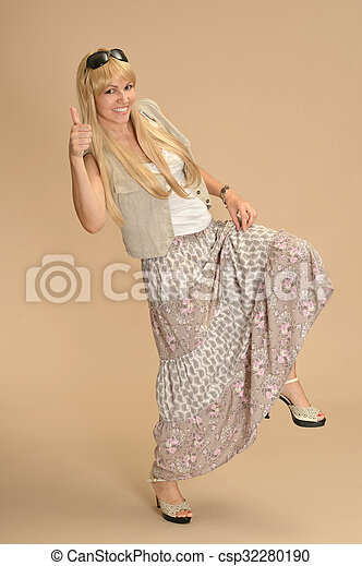 woman in dress with thumb up - csp32280190