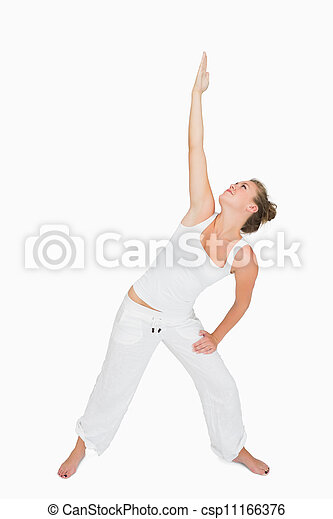 Woman in extended triangle yoga pose - csp11166376