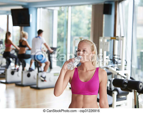 Young healthy blonde woman in fitness gym drink water stock woman in fitness gym drink water stock photo sciox Choice Image