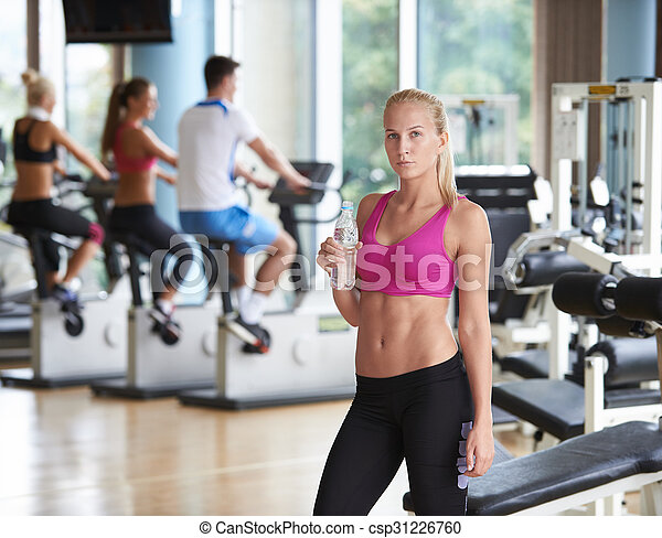 Young healthy blonde woman in fitness gym drink water stock image woman in fitness gym drink water stock photo sciox Choice Image