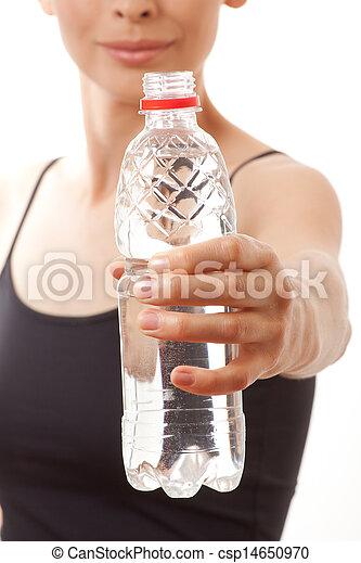 Woman in fitness wear drinking water - csp14650970