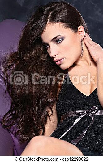 woman in frock on sofa - csp12293622