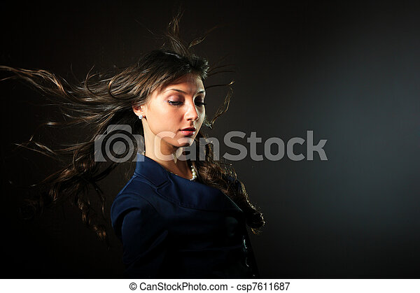 woman in front of a black background  - csp7611687