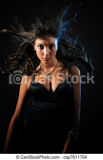 woman in front of a black background  - csp7611704