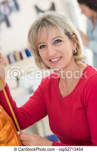 woman in haberdashery store - csp52713454