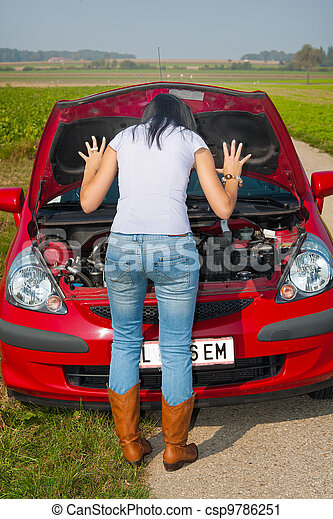 Young woman in her car broke down. engine failure.