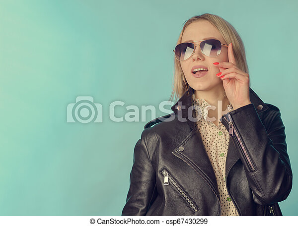 Woman in leather jacket in retro style - csp67430299