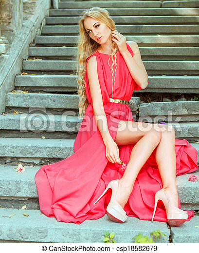 Woman in long red dress outdoors - csp18582679