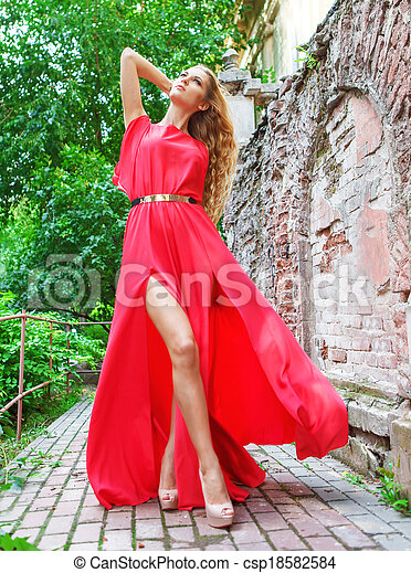 Woman in long red dress outdoors - csp18582584