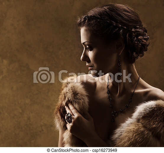 Woman in luxury fur coat, retro vintage style - csp16273949