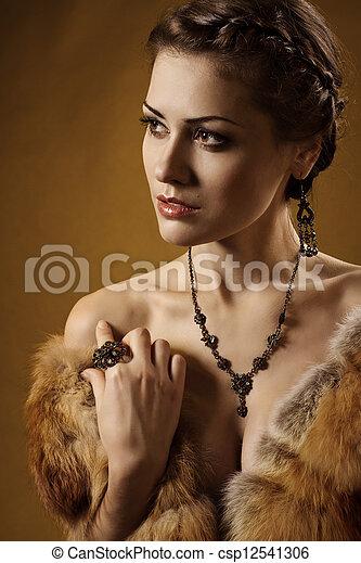 Woman in luxury fur coat. Vintage style - csp12541306