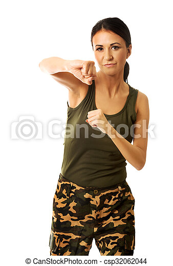 Woman in military clothes boxing to the camera - csp32062044