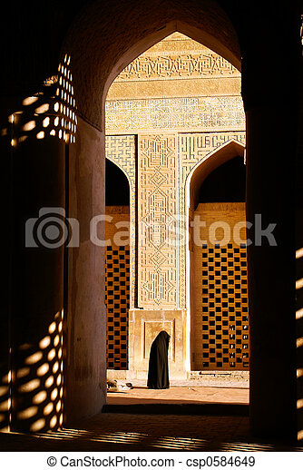 Woman in mosque - csp0584649