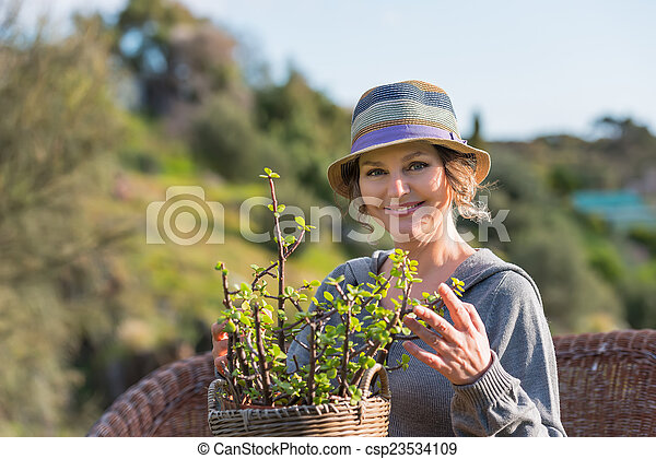 Woman in nature with plant - csp23534109