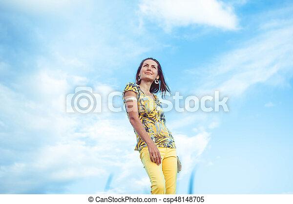 Woman in pants sky - csp48148705