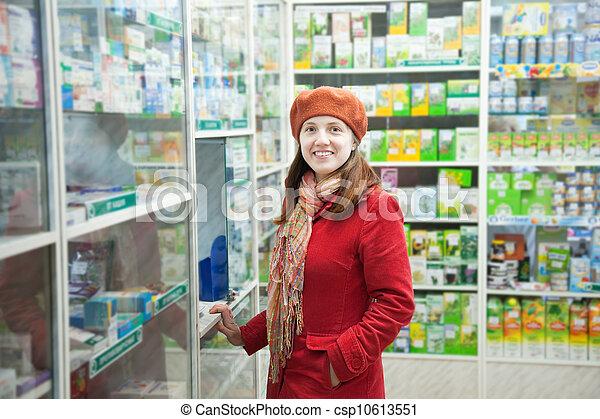 Woman in pharmacy drugstore - csp10613551