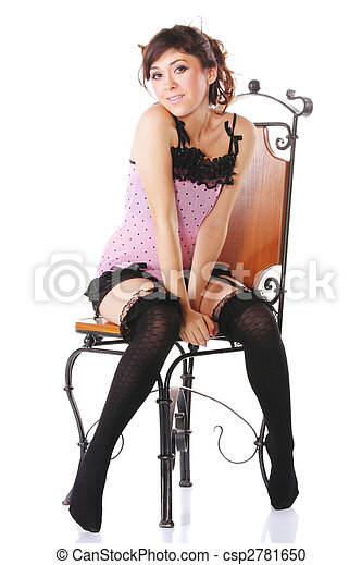 Woman in pink sitting on chair - csp2781650