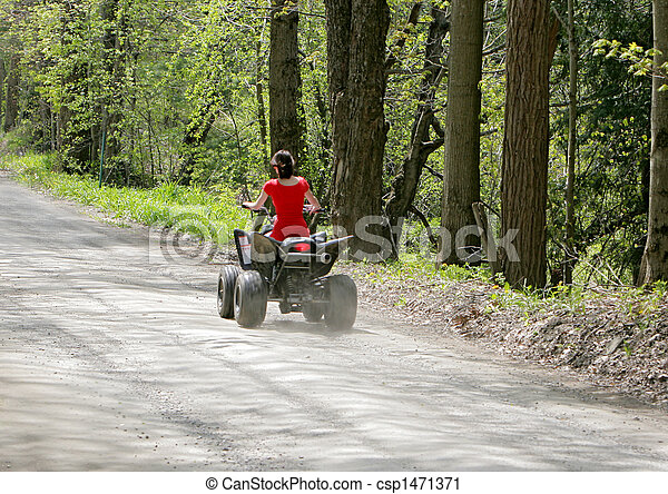 woman in red on four wheeler - csp1471371