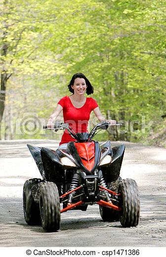 woman in red on four wheeler - csp1471386