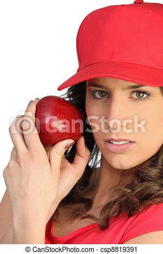 Woman in red with a red apple - csp8819391