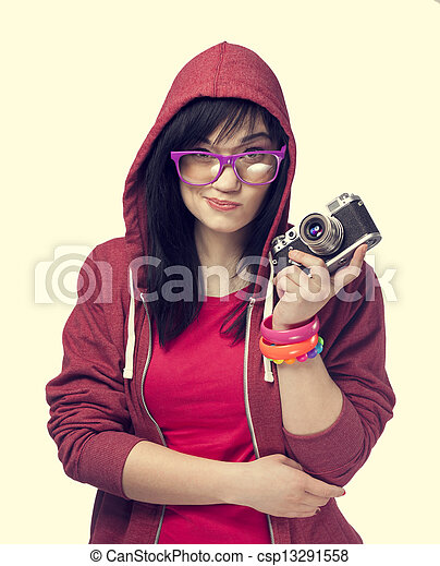 woman in red with camera at white background. - csp13291558