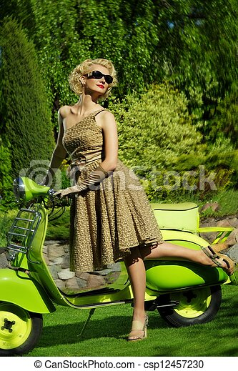 Woman in retro dress with a scooter - csp12457230