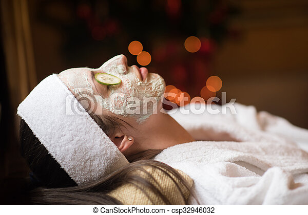 woman in spa  with cosmetic mask - csp32946032