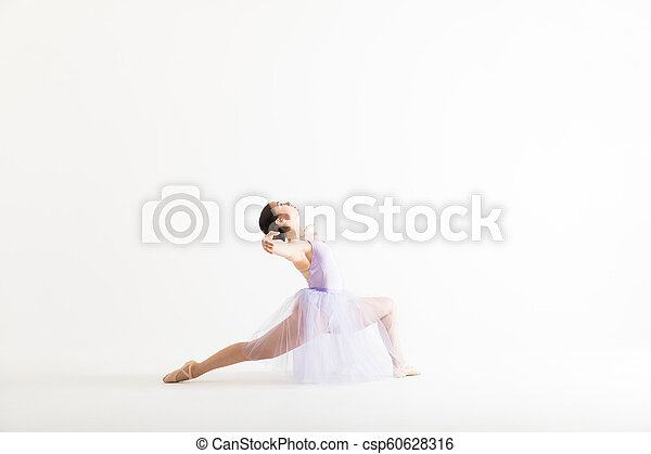 Woman In Tutu Performing A Dance Routine Over White Background