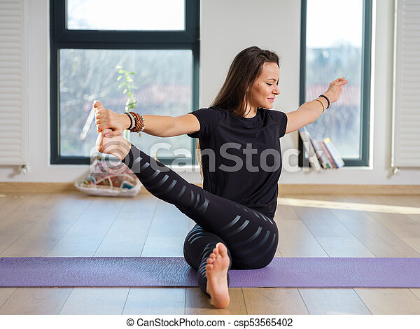 Woman In Various Yoga Postures Young Woman Yoga Teacher In Her Studio Taking Various Poses By The Window