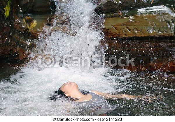 Woman in waterfall - csp12141223